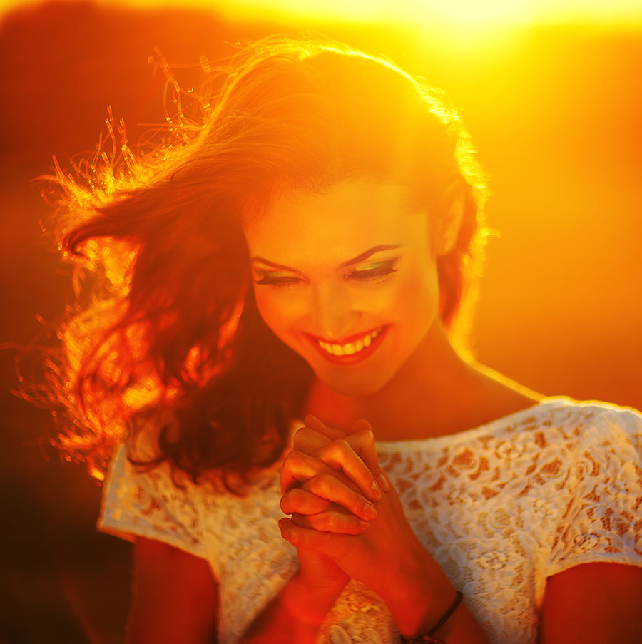 happy woman in golden sunlight