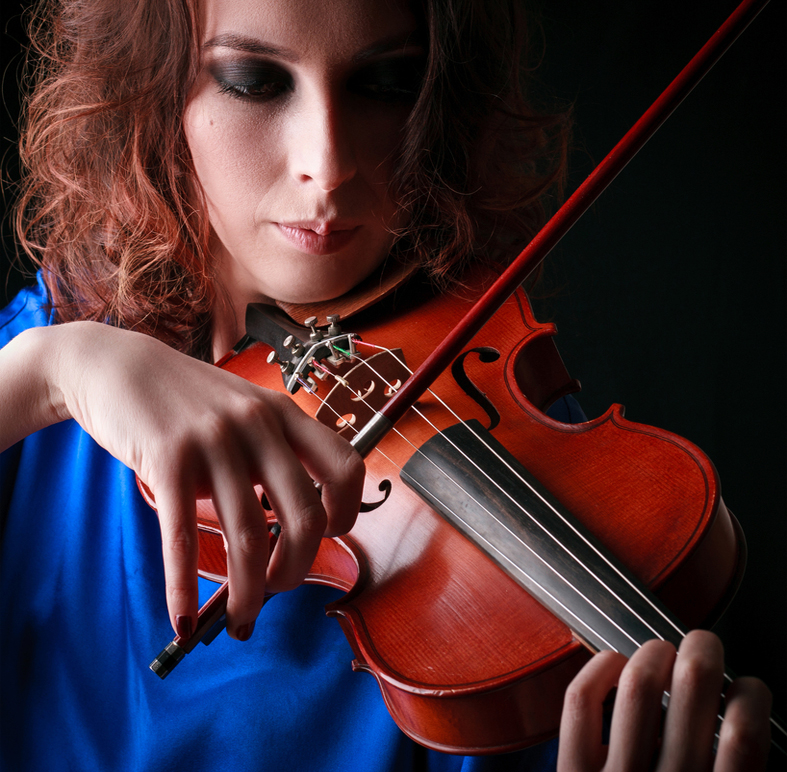 Woman playing violin of hope
