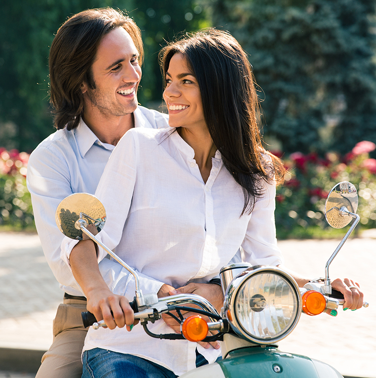 Affirming couple on scooter