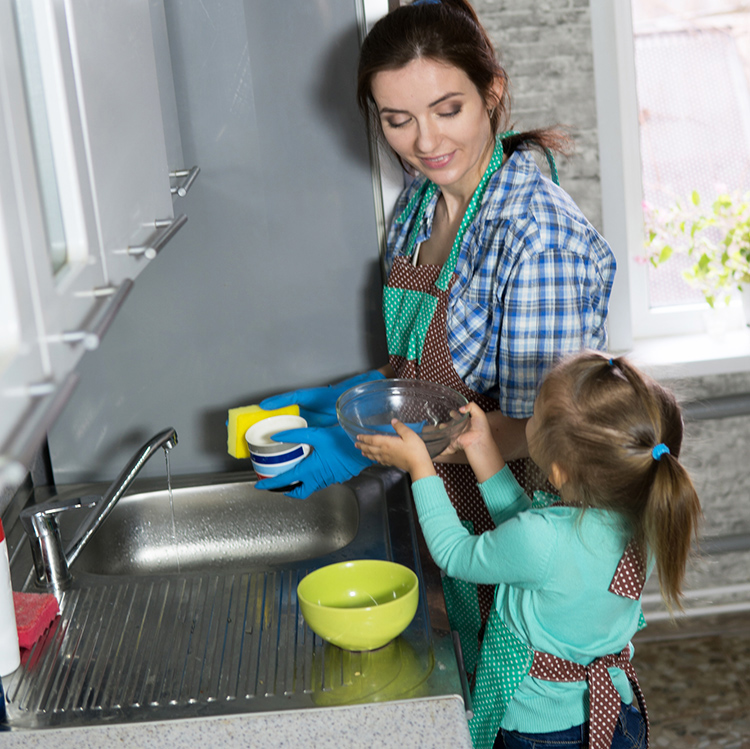 mom and daughter washing dishes