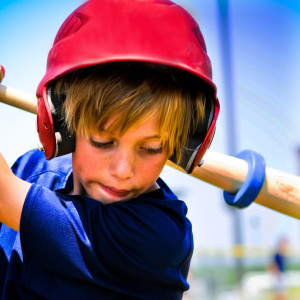 boy swinging baseball bat