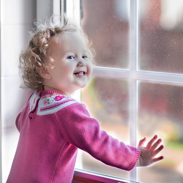 Toddler rejoices at window