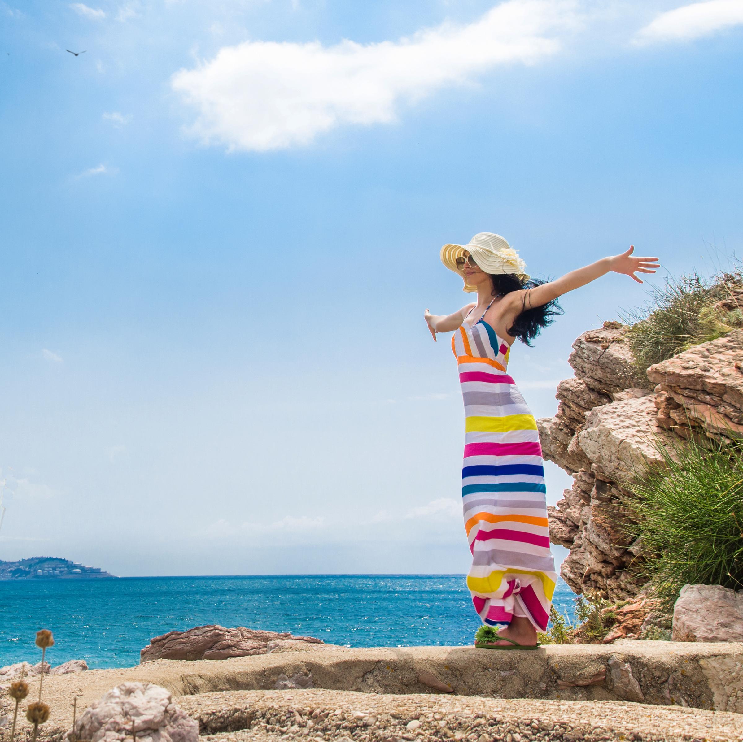 Woman breathing fresh air on the beach