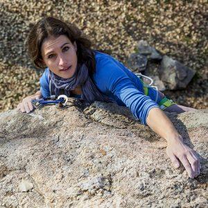 Woman climbing uphill