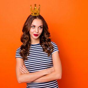 Annoyed woman wearing crown