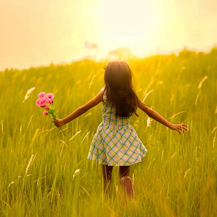 Child in sunny field