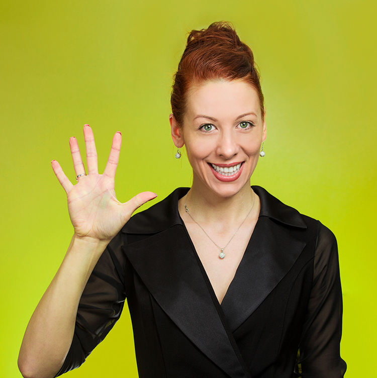 Woman making high five gesture.
