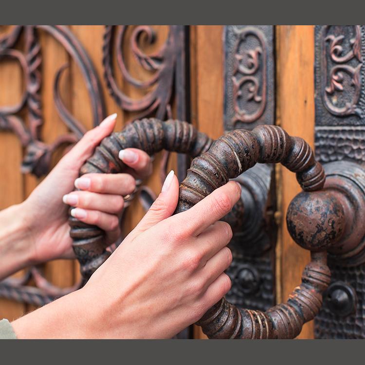 Woman opening door to God