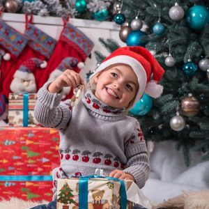 Girl thanking God for Christmas gifts