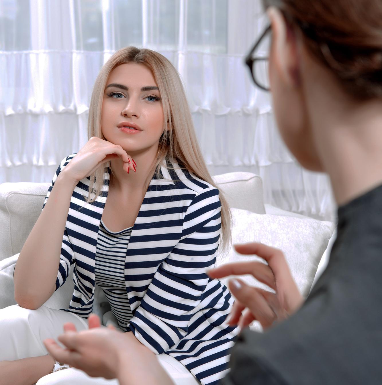 Two women talking in the livingroom