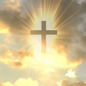 Gold cross in sky